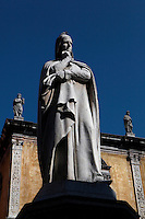 Low angle view of of statue of Dante Alighieri, 1865, by Ugo Zannoni, (1836-1919). Whilst exiled from Florence, the famous Italian poet, Dante, (1265-1321), lived in Verona. This monument was erected to commemorate the 600th anniversary of his birth. In the background statues of illustrious citizens of Verona crown the Loggia del Consiglio. Picture by Manuel Cohen.