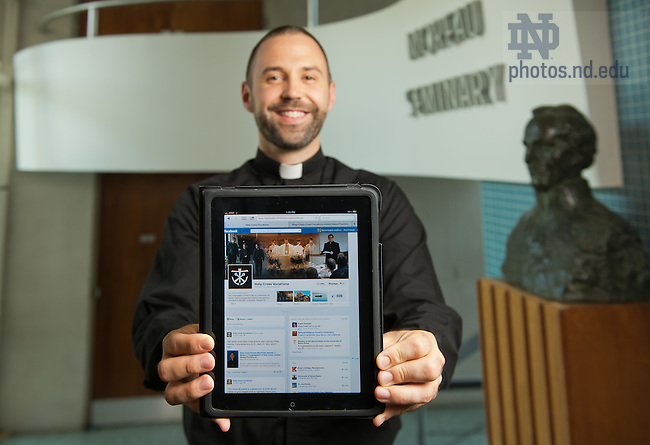 June 28, 2012; Rev. Andrew Gawrych, C.S.C., Associate Director of Vocations, shows the Office of Vocations Facebook page on an iPad...Photo by Matt Cashore/University of Notre Dame