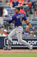 Colorado Rockies left fielder Carlos Gonzalez #5 swings at a pitch during a game against the Atlanta Braves at Turner Field on September 3, 2012 in Atlanta, Georgia. The Braves  defeated the Rockies 6-1. (Tony Farlow/Four Seam Images).