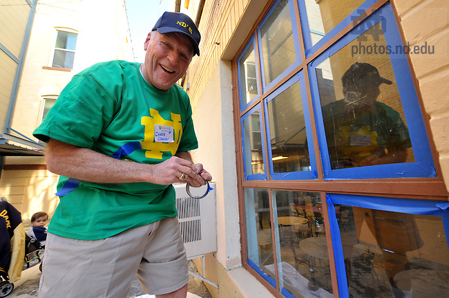 Chuck Lennon works on the Alumni Association service project, painting and general maintenace at the Healy-Murphy Center in San Antonio, a center for at-risk youth.
