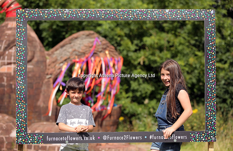 Pictured: Isabel Pearce 10 with younger brother Ben, 7 by the mythical beast sculpture. Saturday 13 August 2016<br />Re: Grow Wild event at  Furnace to Flowers site in Ebbw Vale, Wales, UK