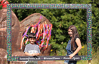 Pictured: Isabel Pearce 10 with younger brother Ben, 7 by the mythical beast sculpture. Saturday 13 August 2016<br />
