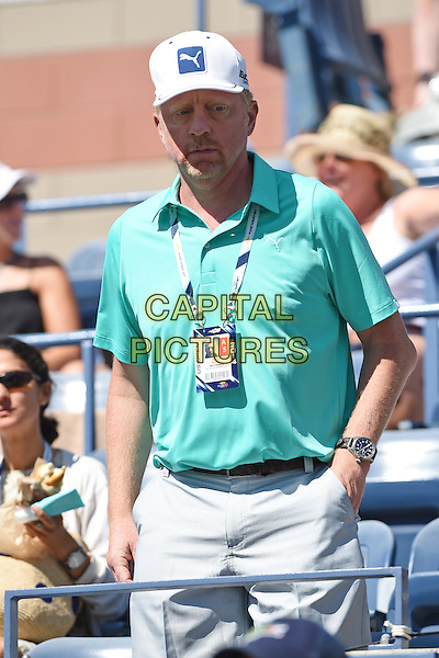 FLUSHING NY- AUGUST 28: Boris Becker is seen  on Arthur Ashe stadium at the USTA Billie Jean King National Tennis Center on August 28, 2014 inFlushing Queens. <br /> CAP/MPI/mpi04<br /> &copy;mpi04/MediaPunch/Capital Pictures