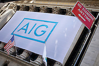 The flag of American International Group is displayed outside the NYSE's building in New York. 15/10/2012. American International Group, Inc. (AIG) is a leading international insurance organization serving customers in more than 130 countries. Photo by Eduardo Munoz Alvarez / VIEWpress.