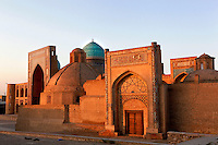 Madrasah of Seyid Amir Alim-Khan, 14th century, and in the background, Madrasah of Miri-Arab, 16th century, Bukhara, Uzbekistan, pictured on July 7, 2010, glowing in the warm light of a late afternoon in summer. Bukhara, a city on the Silk Route is about 2500 years old. Its long history is displayed both through the impressive monuments and the overall town planning and architecture.
