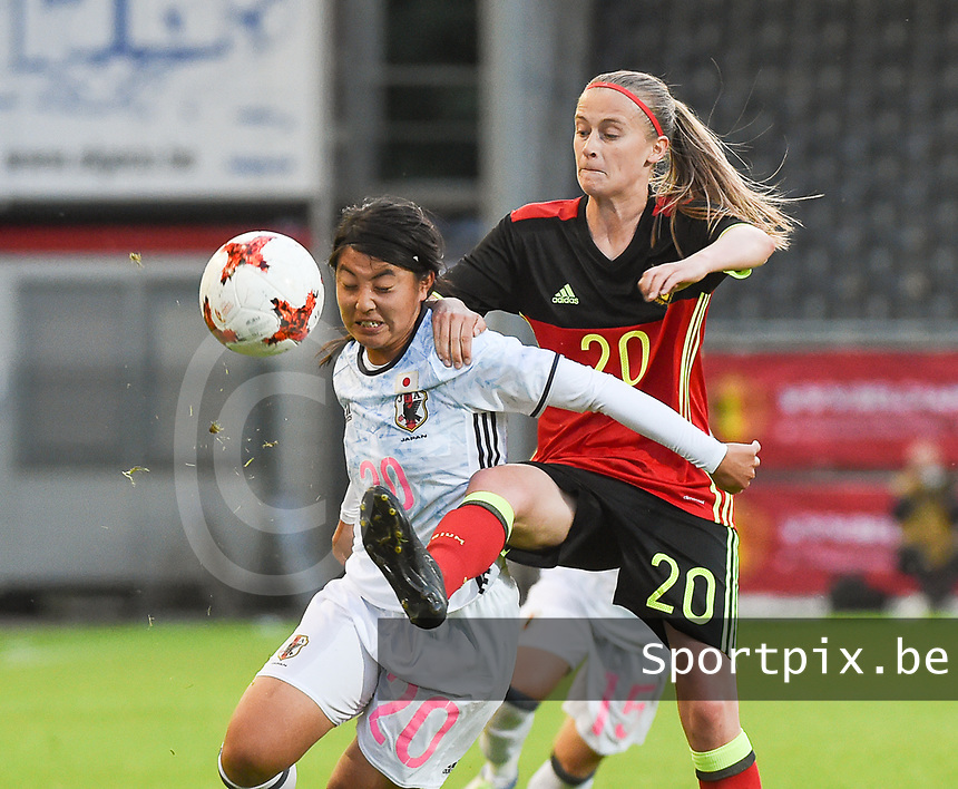 20170613 - LEUVEN ,  BELGIUM : Belgian Julie Biesmans (R) and Japanese Ayumi Oya (L) pictured during the female soccer game between the Belgian Red Flames and Japan , a friendly game before the European Championship in The Netherlands 2017  , Tuesday 13 th Juin 2017 at Stadion Den Dreef  in Leuven , Belgium. PHOTO SPORTPIX.BE | DIRK VUYLSTEKE
