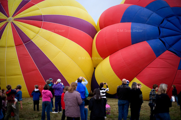 Spectators watch as balloons inflate at the Great Prosser Balloon Rally in Prosser, Washington, USA.