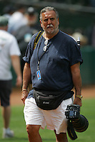 OAKLAND, CA - MAY 1: TOPPS photographer Mickey Palmer works during the game between the Seattle Mariners and Oakland Athletics at the Oakland-Alameda County Coliseum in Oakland, California on May 1, 2005. Photo by Brad Mangin