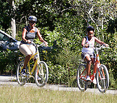 Michelle Obama trails Sasha Obama during a family bike ride in Manuel Correllus State Forest in West Tisbury, Massachusetts, Friday, August 27, 2010. President Obama and daughter Malia followed within 30 seconds..Credit: Vincent DeWitt - Pool via CNP