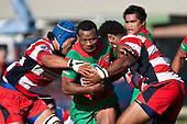 Misi Tupou gets double tackled by Osaiasi Koloamatangi & Viliame Setitaia. Counties Manukau Premier Club Rugby game bewtween Waiuk & Karaka played at Waiuku on Saturday April 11th, 2010..Karaka won the game 24 - 22 after leading 21 - 9 at halftime.
