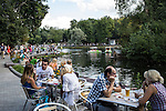 Patrons sit at one of many cafes near Golitsinsky Pond in Gorky Park on Saturday, August 17, 2013 in Moscow, Russia.