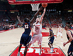 Wisconsin Badgers forward Mike Bruesewitz (31) shoots the ball over the out stretched arm of Illinois Fighting Illini Nnanna Egwu (32) during a Big Ten Conference NCAA college basketball game on Sunday, March 4, 2012 in Madison, Wisconsin. The Badgers won 70-56. (Photo by David Stluka)
