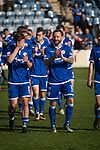Home team players led by Stephen Dobie (11) applauding their fans after the last home game of the season at Palmerston Park, Dumfries as Queen of the South (in blue) hosted Dundee United in a Scottish Championship fixture. The home has played at the same ground since its formation in 1919. Queens won the match 3-0 watched by a crowd of 1,531 spectators.