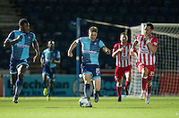 Dayle Southwell of Wycombe Wanderers heads forward under pressure from Chris Eagles of Accrington Stanley with Aaron Pierre of Wycombe Wanderers in support during the Sky Bet League 2 match between Wycombe Wanderers and Accrington Stanley at Adams Park, High Wycombe, England on 16 August 2016. Photo by Kevin Prescod.