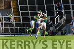 Kerrys David Moran and Killian Young put  Darren Hughes Monaghan in a Kerry sandwich during their NFL clash in Fitzgerald Stadium on Sunday
