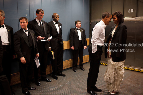 President Barack Obama and First Lady Michelle Obama share a private moment in a freight elevator at an Inaugural Ball. Washington, D.C. 1/20/09.Mandatory Credit: Pete Souza - White House via CNP
