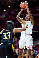 College Park, MD - DEC 6, 2016: Maryland Terrapins guard Shatori Walker-Kimbrough (32) hits a jump shot over Towson Tigers center Daijha Thomas (33) during game between Towson and Maryland at XFINITY Center in College Park, MD. The Terps defeated the Tigers 97-63. (Photo by Phil Peters/Media Images International)