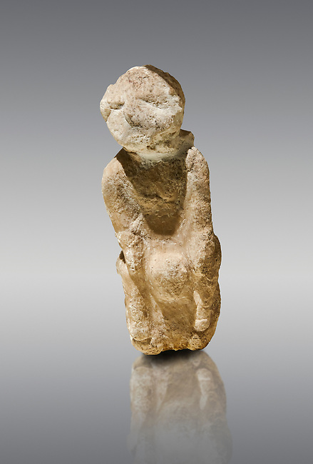 Seated marble goddess. Catalhoyuk Collections. Museum of Anatolian Civilisations, Ankara. Catalhoyuk Collections. Museum of Anatolian Civilisations, Ankara. Against a grey background