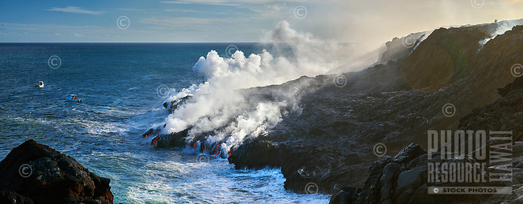 A panoramic image of the Kamokuna lava flow ocean entry showing spectators in adventure boats and on the cliff, Big Island of Hawai'i.