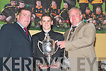Gavin Tucker receives the Young Player of the Year trophy from John Keogh (right) and Chairman Patrick OSullivan (left) at the Dr Crokes GAA Club Social in The Dromhall Hotel, Killarney, last Sunday night..