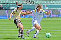 Shannon Boxx #7 of the Los Angeles Sol moves the ball past Tiffany Weimer #8 of FC Gold Pride during their match at Home Depot Center on April 19, 2009 in Carson, California.