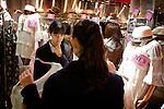 (Eng) Tokyo, March 8, 2010 - At the &quot;109&quot; shop in the Shibuya district. Two schoolgirls come and try new collections in one of the numerous shops of this fashion temple.<br /> <br /> (Fr)Tokyo, 8 mars 2010 - Au &quot;109&quot; dans le quartier de Shibuya. Deux collegiennes viennent essayer les dernieres collections d'une des nombreuses boutiques de ce temple de la mode tokyoite.