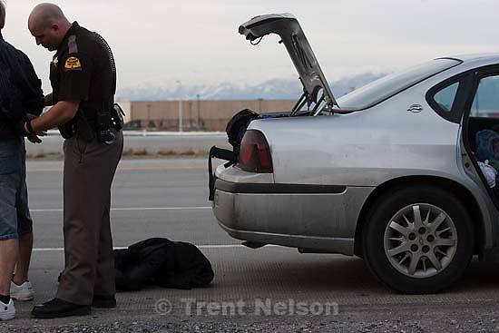 Salt Lake City - out with the criminal interdiction unit of the Utah Highway Patrol Wednesday March 11, 2009. Arrests are made after a search in which troopers found more than four pounds of marijuana hidden in the trunk of a car.
