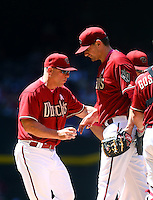May 10, 2015; Phoenix, AZ, USA; Arizona Diamondbacks manager Chip Hale (left) pulls pitcher Daniel Hudson from the game against the San Diego Padres at Chase Field. Mandatory Credit: Mark J. Rebilas-USA TODAY Sports
