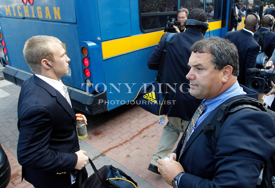 Michigan safety Jordan Kovacs, left, walks by head coach Brady Hoke, right, as their team arrives at Michigan Stadium before an NCAA college football game with Notre Dame, Saturday, Sept. 10, 2011, in Ann Arbor, Mich. (AP Photo/Tony Ding)
