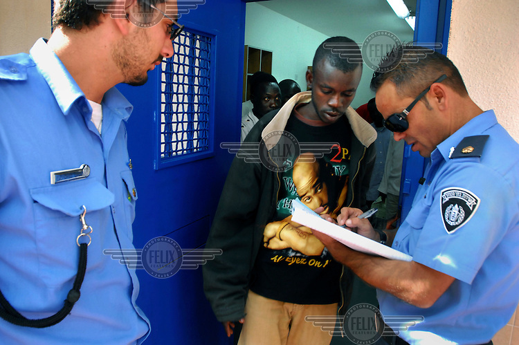 A refugee from Darfur is identified by Israeli prison guards, as he is released from Ketziot Prison, southern Israel. After illegally crossing the Israeli-Egyptian border and spending time in detention, Darfur refugees were spread between Israeli towns and farms, which offer them job opportunities.