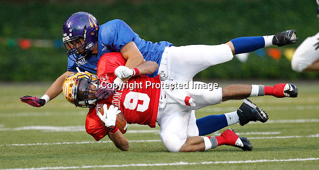 West wide receiver Terelle Bolton (9) of Columbia River is tackled by East defender during Freedom Bowl at Kiggins Bowl.  (Steve Dipaola for the Columbian)