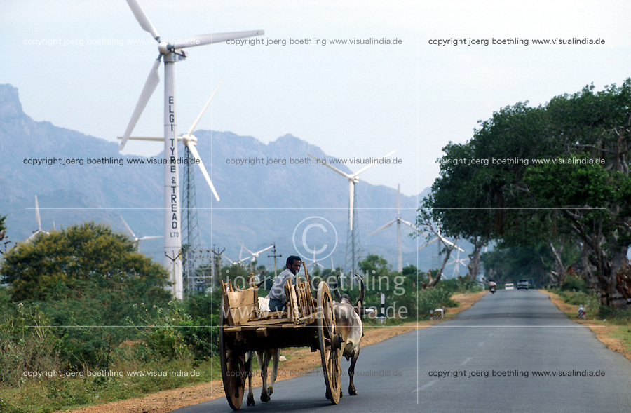 INDIA Tamil Nadu, Kanyakumari,  Cape Comorin, contrast modern between traditional, farmer with bullock cart and site for wind turbines / INDIEN Kap Komorin, Farmer mit Ochsenkarren vor Windpark