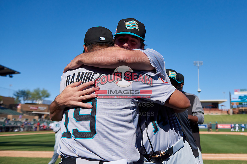 Salt River Rafters pitcher Zach Neff (14) celebrates with Luis Ramirez (19), both of the Minnesota Twins organization, celebrate after winning the Arizona Fall League Championship Game against the Surprise Saguaros on October 26, 2019 at Salt River Fields at Talking Stick in Scottsdale, Arizona. The Rafters defeated the Saguaros 5-1. (Zachary Lucy/Four Seam Images)