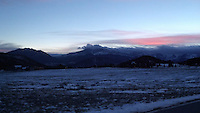 Sunset over snowy Rocky Mountains
