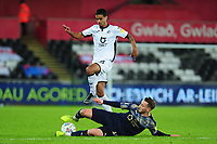 Kyle Naughton of Swansea City under pressure from Mike-Steven Bähre of Barnsley during the Sky Bet Championship match between Swansea City and Barnsley at the Liberty Stadium in Swansea, Wales, UK. Sunday 29 December 2019