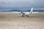 Flybe plane on sandy airstrip Isle of Barra airport, Barra, Outer Hebrides, Scotland, UK