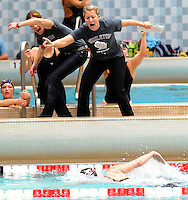 Middleton coaches cheer on Middleton senior Katie Delaney in her 500 yard freestyle victory in the WIAA Division 1 state girls swimming meet at the University of Wisconsin Natatorium on Saturday, 11/13/10 in Madison, Wisconsin