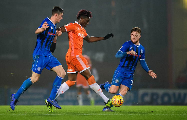 Blackpool's Armand Gnanduillet vies for possession with Rochdale's Ryan Delaney, left, and Rochdale's Callum Camps<br /> <br /> Photographer Chris Vaughan/CameraSport<br /> <br /> The EFL Sky Bet League One - Rochdale v Blackpool - Wednesday 26th December 2018 - Spotland Stadium - Rochdale<br /> <br /> World Copyright © 2018 CameraSport. All rights reserved. 43 Linden Ave. Countesthorpe. Leicester. England. LE8 5PG - Tel: +44 (0) 116 277 4147 - admin@camerasport.com - www.camerasport.com