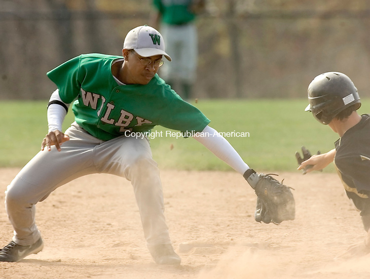 BEACON FALLS, CT- 23 APRIL 2008 --042308JS13--Woodland's Ryan Genua (21) slides around the tag of Wilby's Juan Mercedes (2) during their game Wednesday at Woodland Regional High School in Beacon Falls. <br /> Jim Shannon / Republican-American
