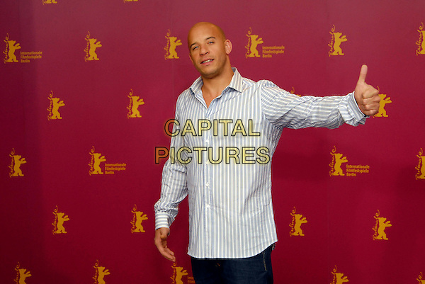 "VIN DIESEL .Photocall for ""Find Me Guilty"" at the 56th Berlin International Film Festival (Berlinale) in Berlin, Germany..February 16, 2006 .Ref: KRA.half length grey gray white striped shirt sweat patch thumbs up .www.capitalpictures.com.sales@capitalpictures.com.©Capital Pictures"