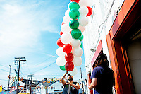 People fill balloons and make balloon arches for the Sunday procession during St. Peter's Fiesta in Gloucester, Massachusetts, USA.