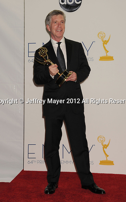 LOS ANGELES, CA - SEPTEMBER 23: Tom Bergeron poses in the press room at the 64th Primetime Emmy Awards held at Nokia Theatre L.A. Live on September 23, 2012 in Los Angeles, California.