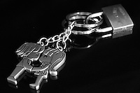 Black &amp; white stock image of metal boy-girl pair key-chain locked together. <br />