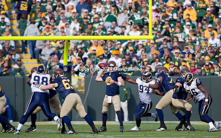 Green Bay Packers quarterback Aaron Rodgers (12) throws a pass during a Week 6 NFL football game against the St. Louis Rams on October 16, 2011 in Green Bay, Wisconsin. The Packers won 24-3. (AP Photo/David Stluka)