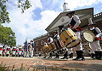The Windsor Fife and Drum Corp performs in front of the Windsor Town Hall,  during the 27th annual Windsor Fife and Drum Corps Muster, groups from Connecticut, New York, New Jersey, Rhode Island, were among the groups participating this year, one of the largest turn outs organizers said.  (Jim Michaud/Journal Inquirer) .