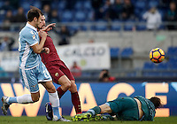 Calcio, Serie A: Lazio vs Roma. Roma, stadio Olimpico, 4 dicembre 2016.<br /> Roma&rsquo;s Kevin Strootman, center, kicks to score as Lazios' Stefan Radu, left, and goalkeeper Federico Marchetti try to stop him during the Italian Serie A football match between Lazio and Rome at Rome's Olympic stadium, 4 December 2016. Roma won 2-0.<br /> UPDATE IMAGES PRESS/Isabella Bonotto