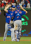 New York Mets left fielder Kirk Nieuwenhuis (9), center, celebrates his team's 8-7 victory over the Washington Nationals with teammate New York Mets catcher Travis d'Arnaud (7) at Nationals Park in Washington, D.C. on Tuesday, September 8, 2015.  The Mets won the game 8-7.<br /> Credit: Ron Sachs / CNP