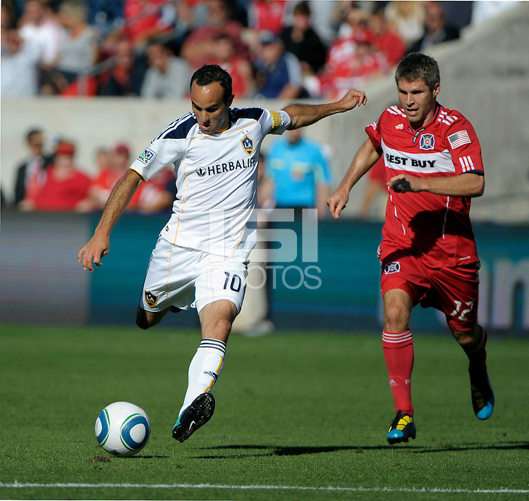 LA Galaxy forward Landon Donovan (10) shoots the ball in front of Chicago midfielder Logan Pause (12).  The LA Galaxy tied the Chicago Fire 1-1 at Toyota Park in Bridgeview, IL on September 4, 2010