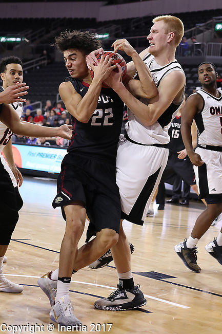 SIOUX FALLS, SD: MARCH 6: D.J. McCall #22 of IUPUI and Mitch Hahn #44 of Omaha battle for possession during the Summit League Basketball Championship on March 6, 2017 at the Denny Sanford Premier Center in Sioux Falls, SD. (Photo by Dick Carlson/Inertia)