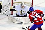 6 February 2010: Pittsburgh Penguins' goaltender Marc-Andre Fleury makes a first period save on center Tomas Plekanec of the Montreal Canadiens at the Bell Centre in Montreal, Quebec, Canada. The Canadiens defeated the Penguins 5-3. Mandatory Credit: Ed Wolfstein Photo